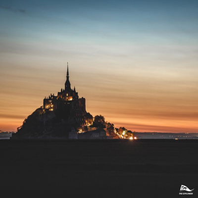 Sun rising behind the Mont Saint Michel 💫 - © @valentinpacaut / @theexplorersofficial